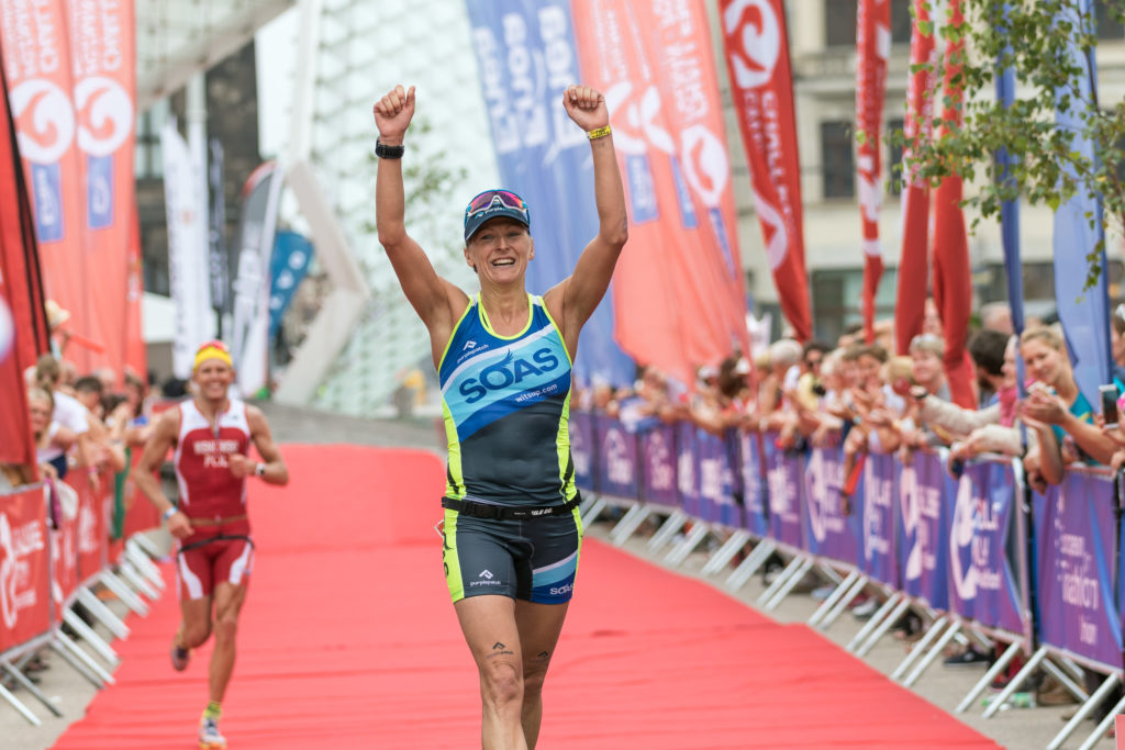 Crossing the line - my first win as a Professional Triathlete