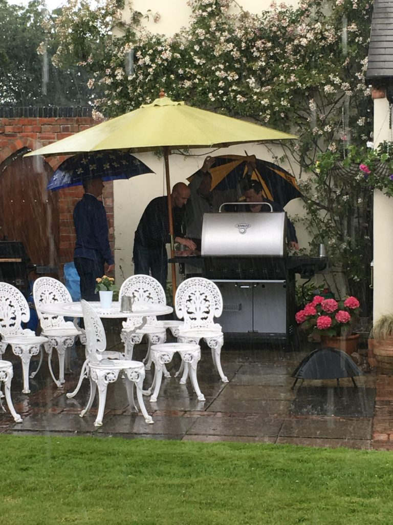 The English Summer and being British! Determined to carry on with the BBQ - in the pouring rain!